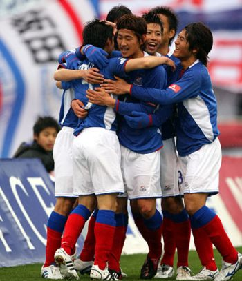 21 Mar 08 - Well whoopey-doo, Marinos celebrate their winner against Oita