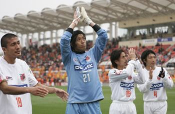 30 Mar 08 - Hero Ezumi salutes the travelling Ardija fans